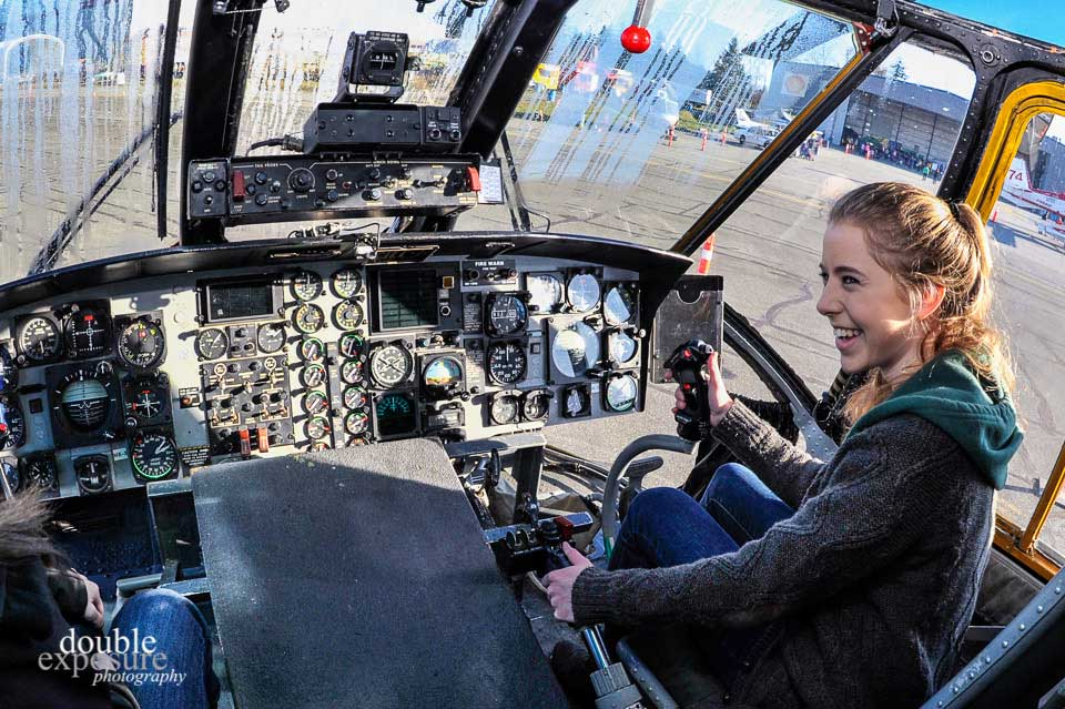 Checking out the controls of a Sea King helicopter