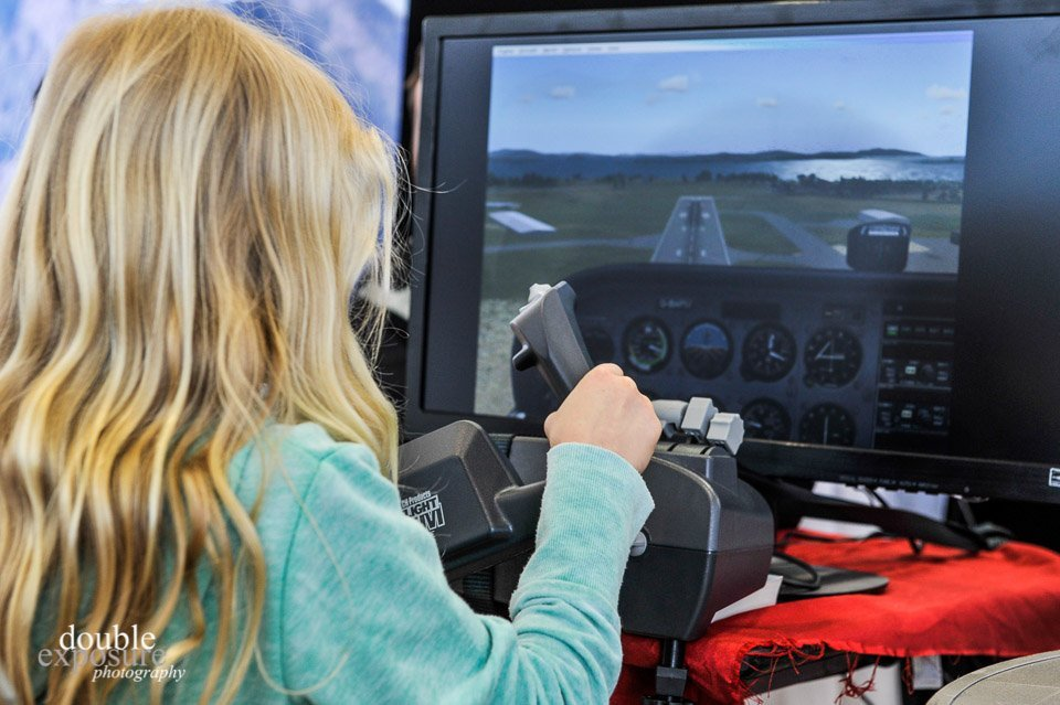 Young girl uses a Flight Simulator at Girls Fly Too