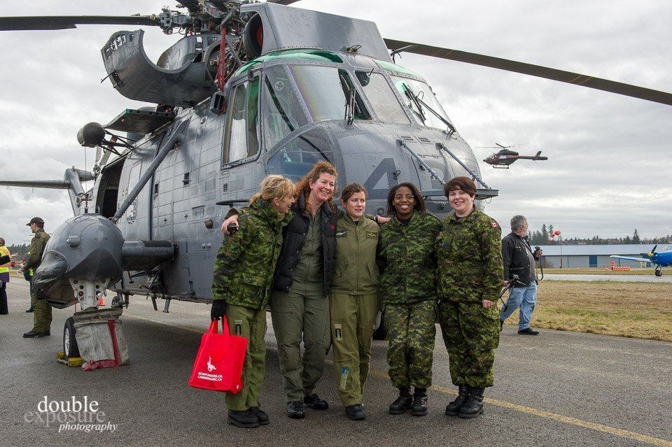 Kirsten (second from left) sharing a laugh with a a female flight crew