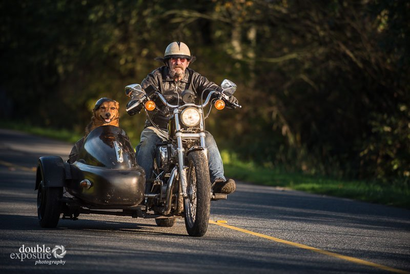 man and motorcycle with dog