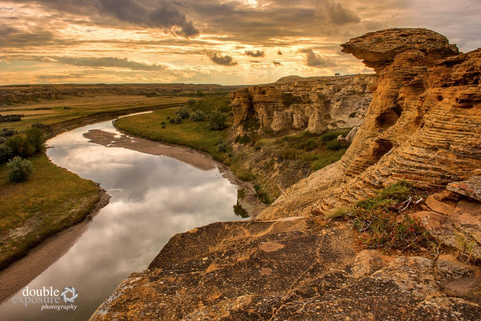 The Milk River flows through the area, slowly but surely creating its art.