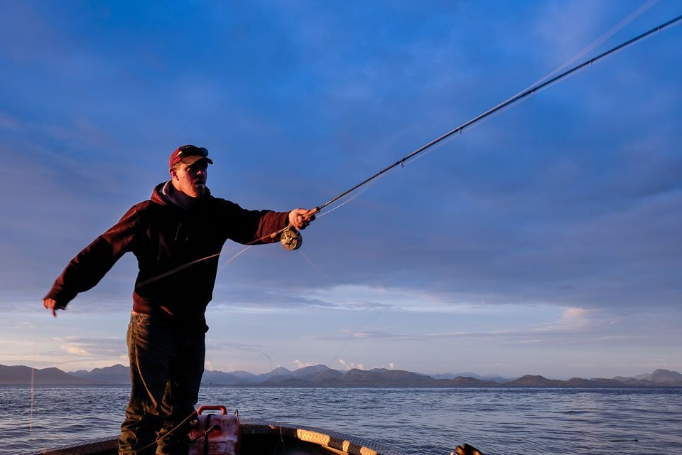 Fisherman casts for salmon