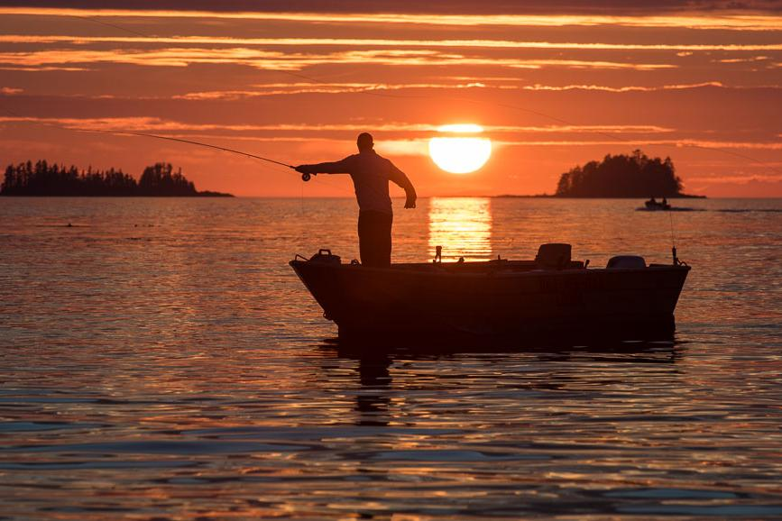 Fisherman at sunset in British Columbia