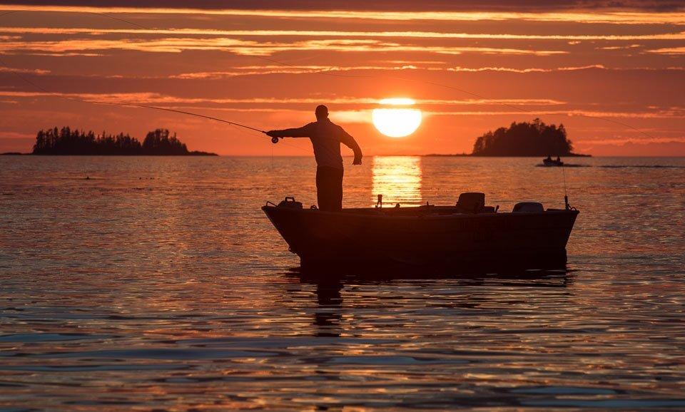 Fisherman at sunset in British Columbia