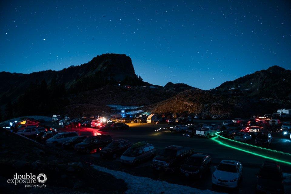 flashlights illuminate a night parking lot at Mt Baker