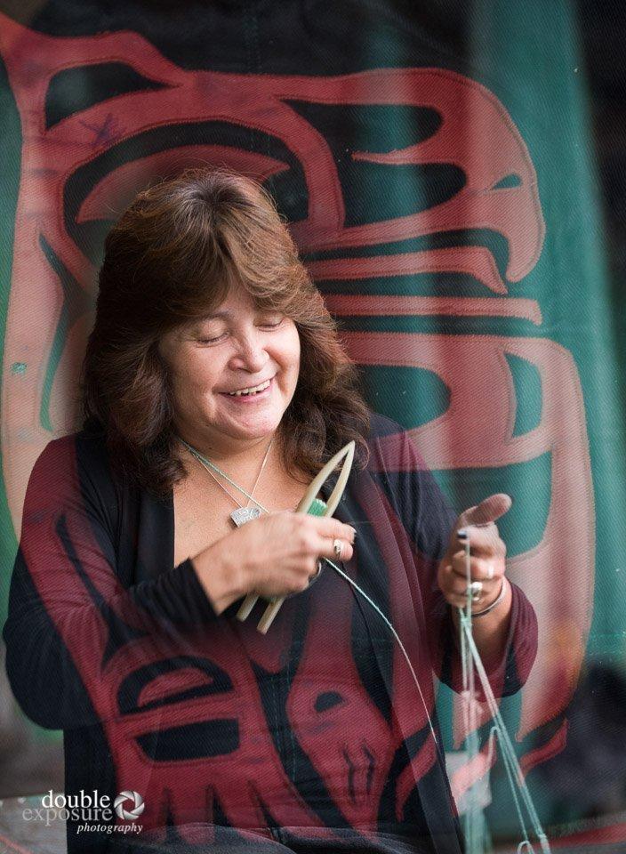 Woman repairs fishnets