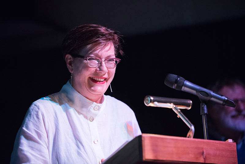 Woman speaks at book launch celebration