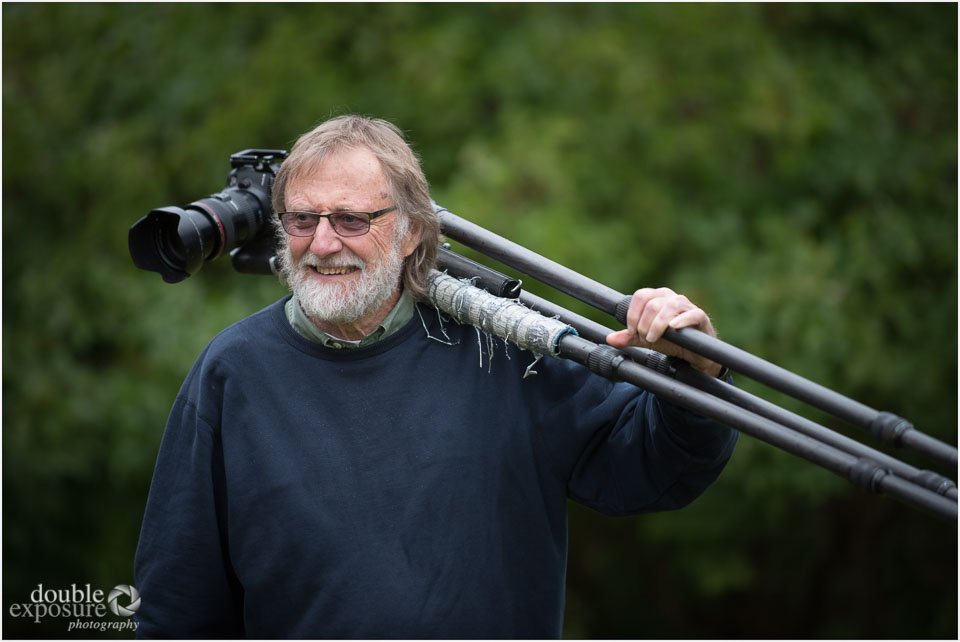 a photographer poses with this tripod.