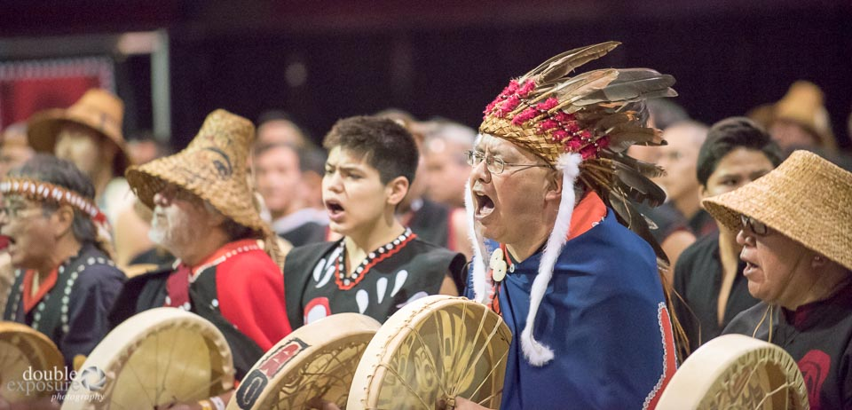 Fierce warriors chant and drum.