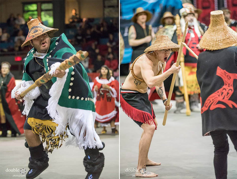 Dancers in regalia appear to be ready to fight.
