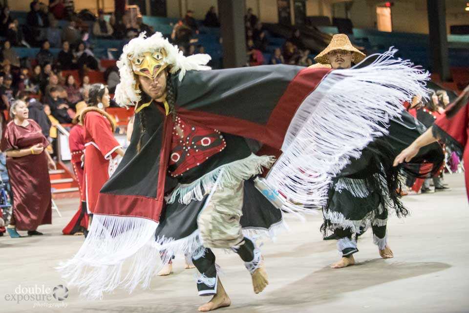 An aboriginal dancer dressed as an eagle to represent his family's clan.