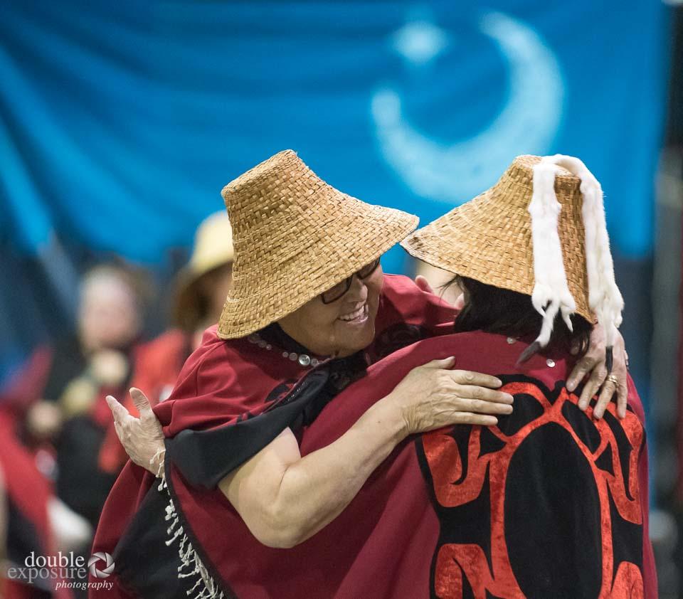 Two woman hug in celebration of friendship.