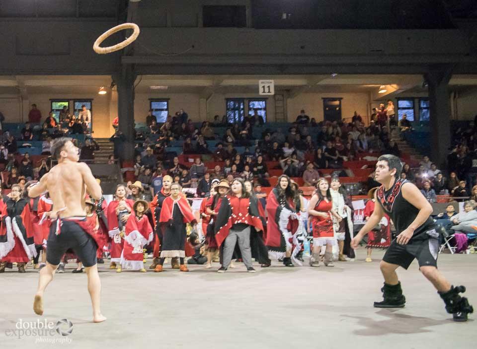 Warriors toss a cedar ring without using their hands.