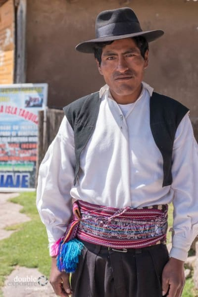 A man checks the clothing worn by the locals.