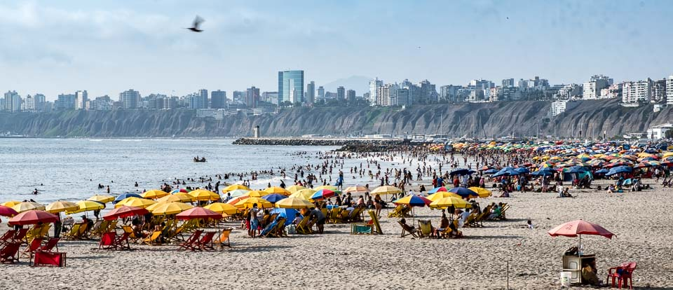 People flock to the beaches of Lima on a sunny day