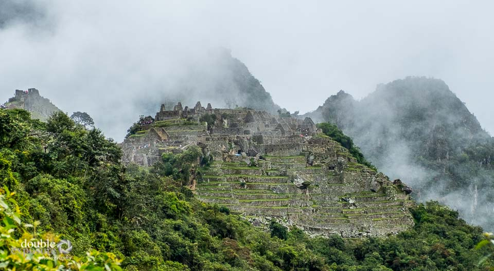 Machu Picchu surrounded by rain clouds.