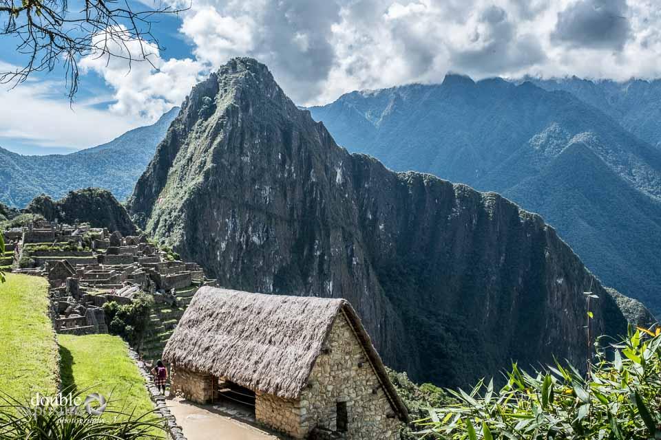 A restored hut overlooks the site of Machu Picchu.