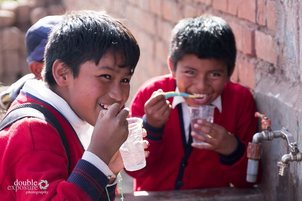 students brush their teeth after lunch