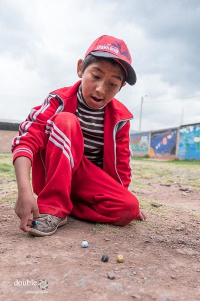 Children play marbles.