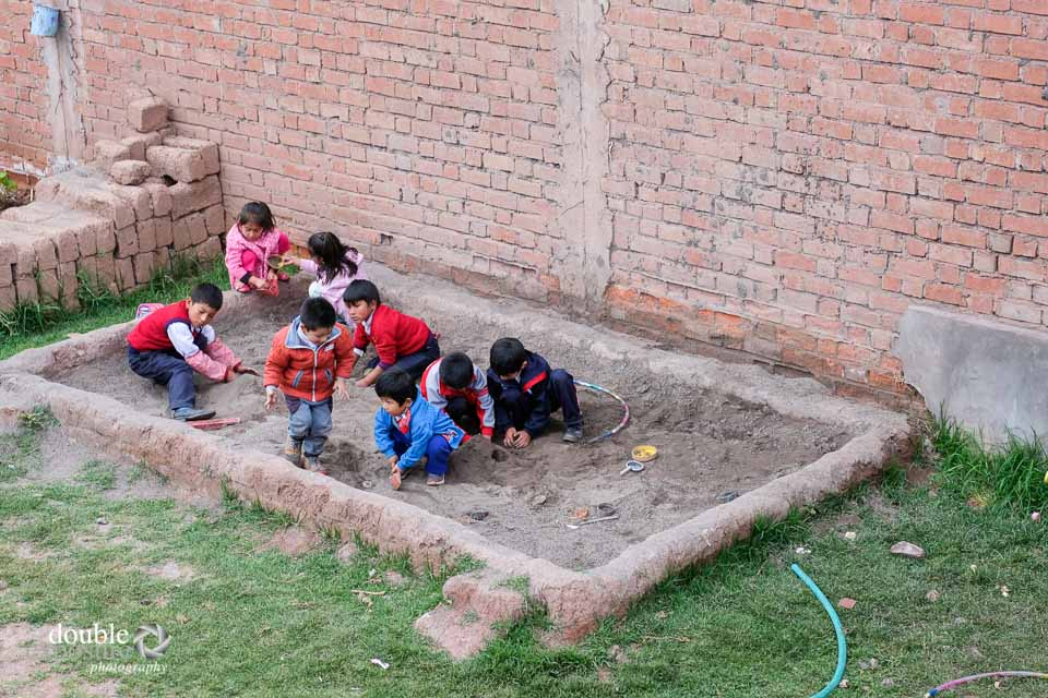 Children love to play in the sandbox.