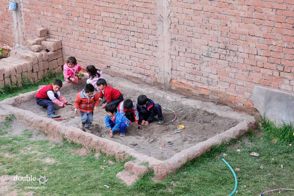 Children love to play in the sandbox.