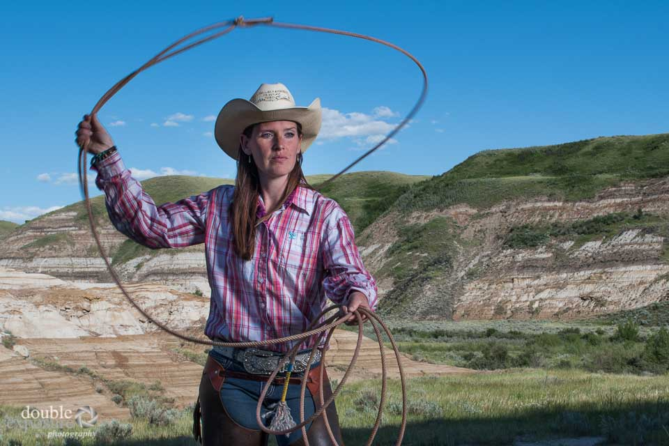 Woman rancher throws a lasso.