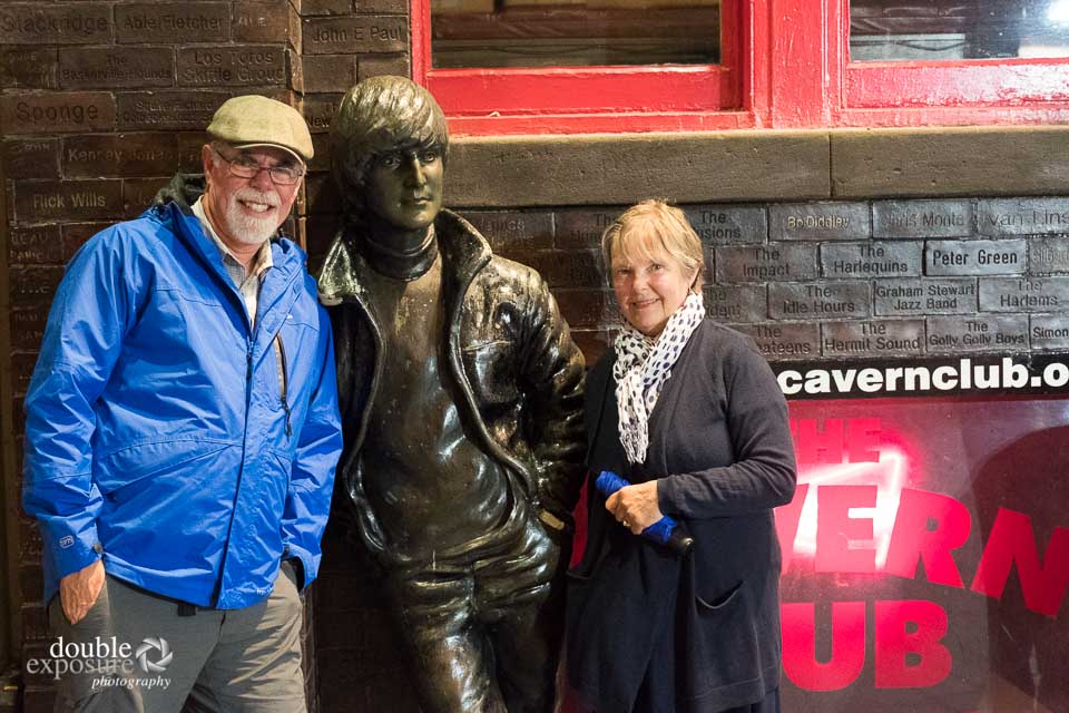 a statue of John Lennon in Liverpool