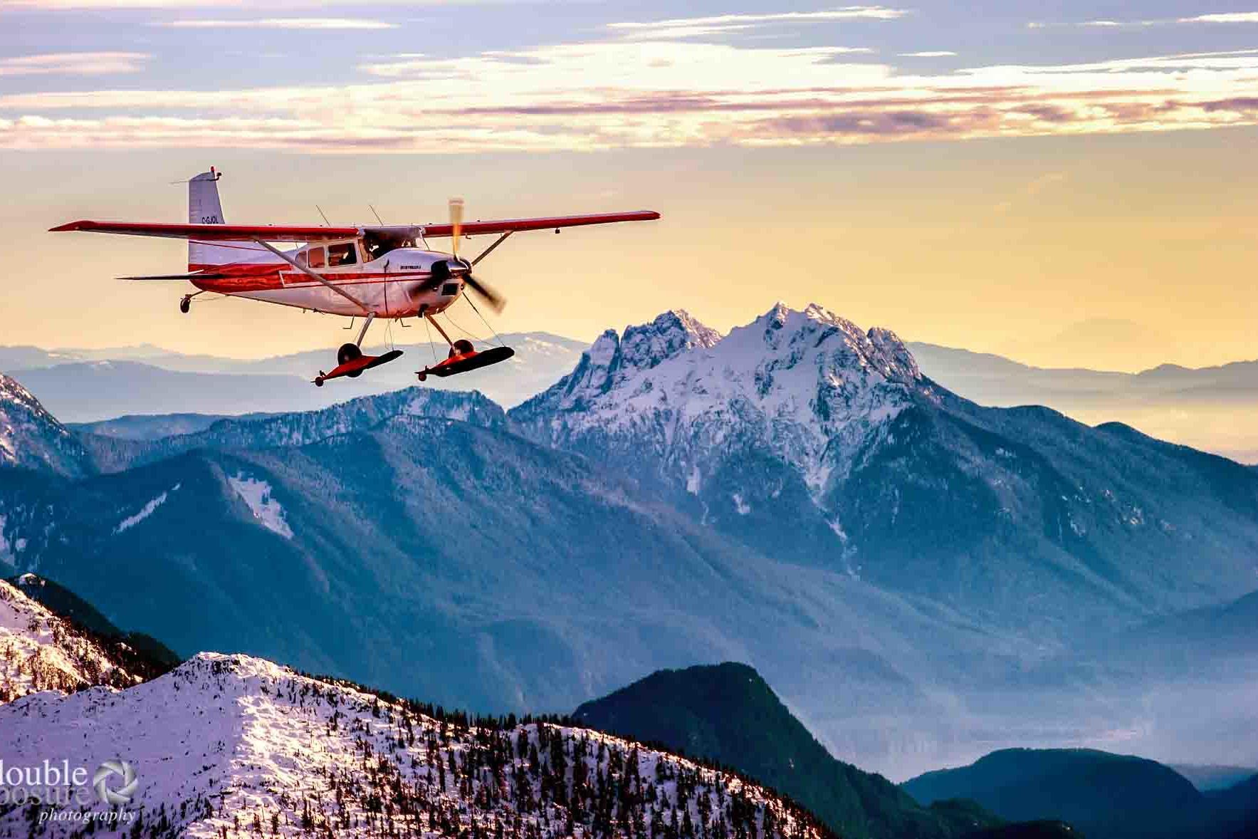 Cessna flies near mountains