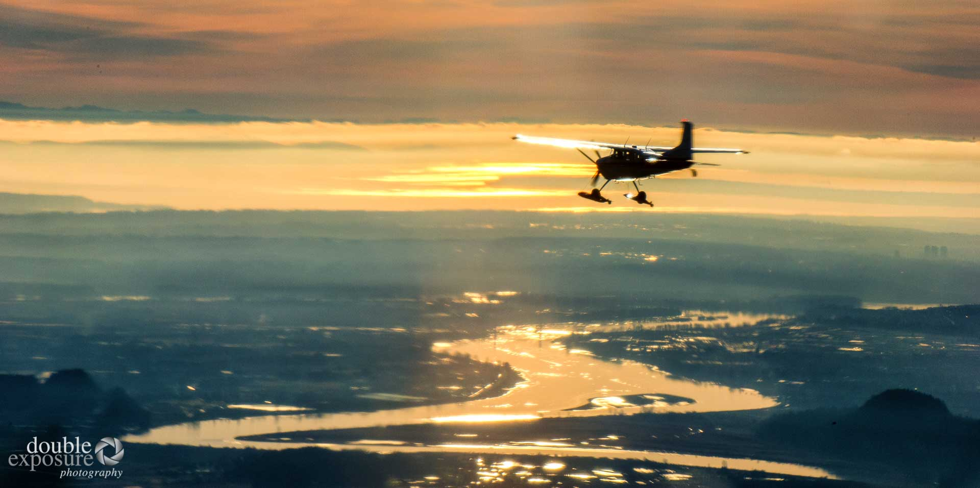 Cessna 180 over Fraser River.