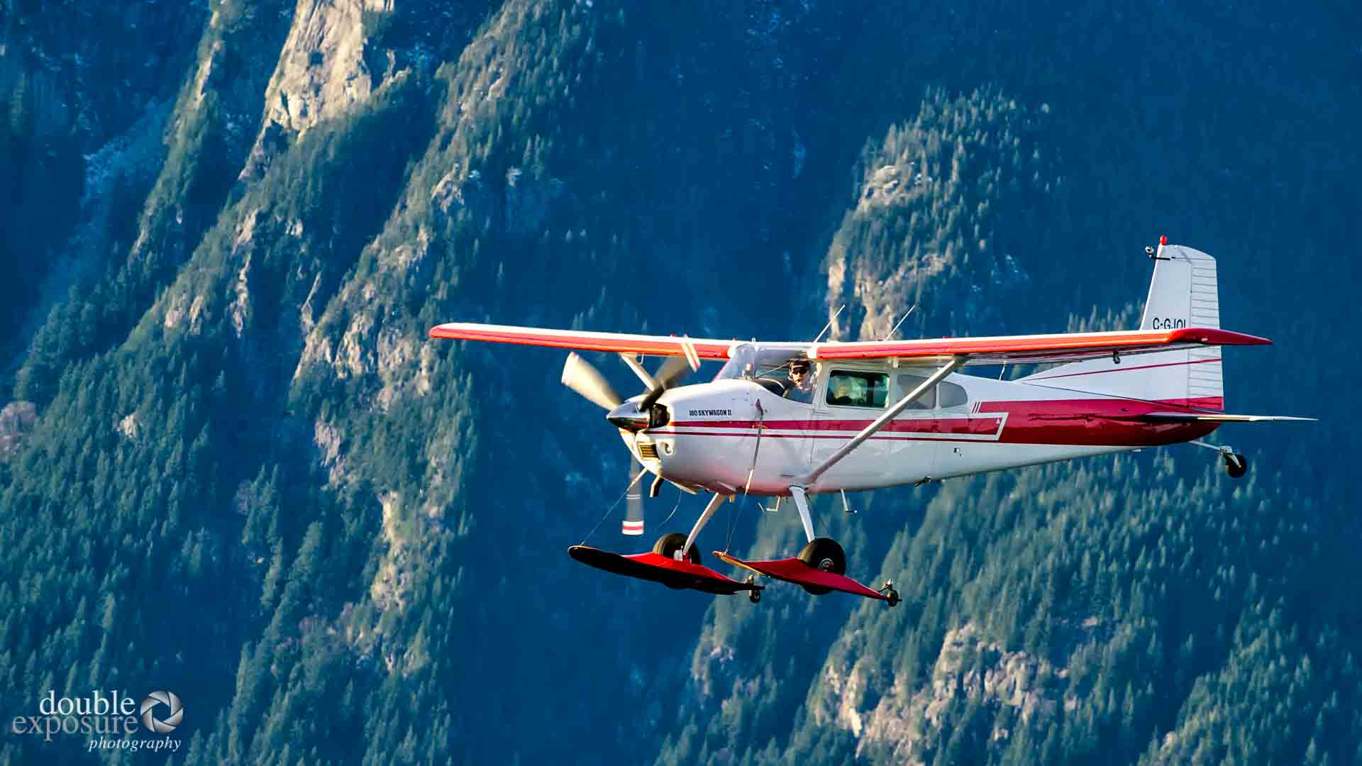 Cessna flying near mountains