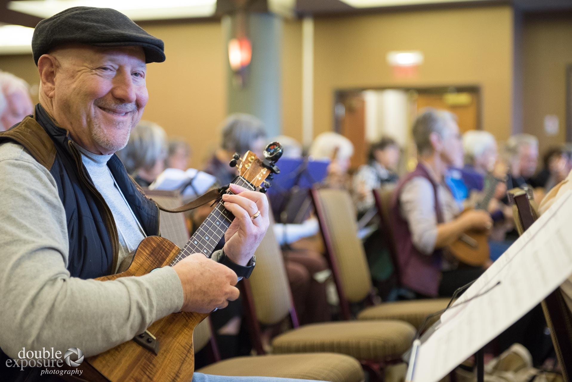 man with ukulele.