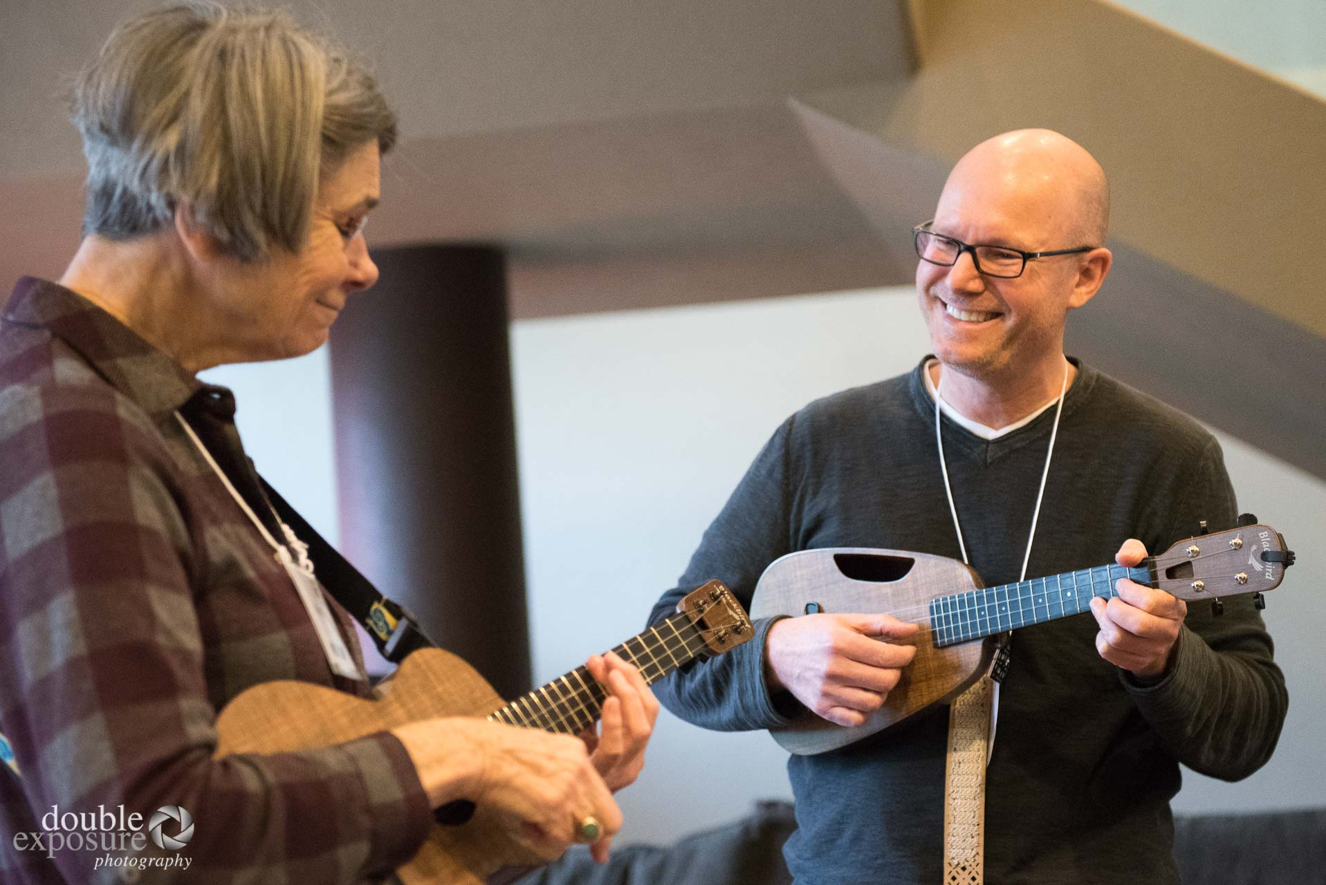 two adults with ukuleles.