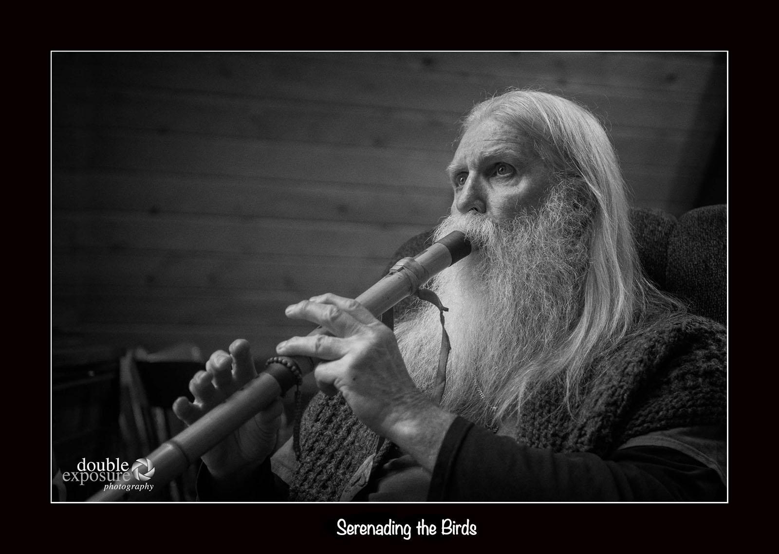 man plays flute for birds