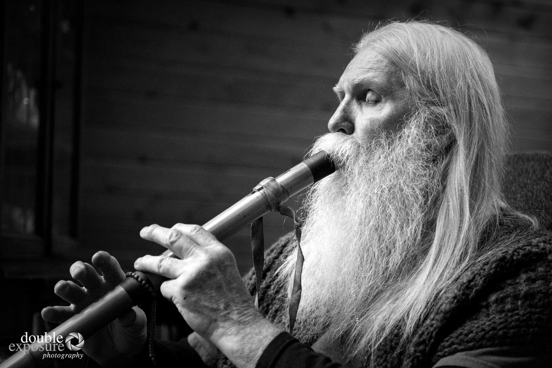 man plays flute