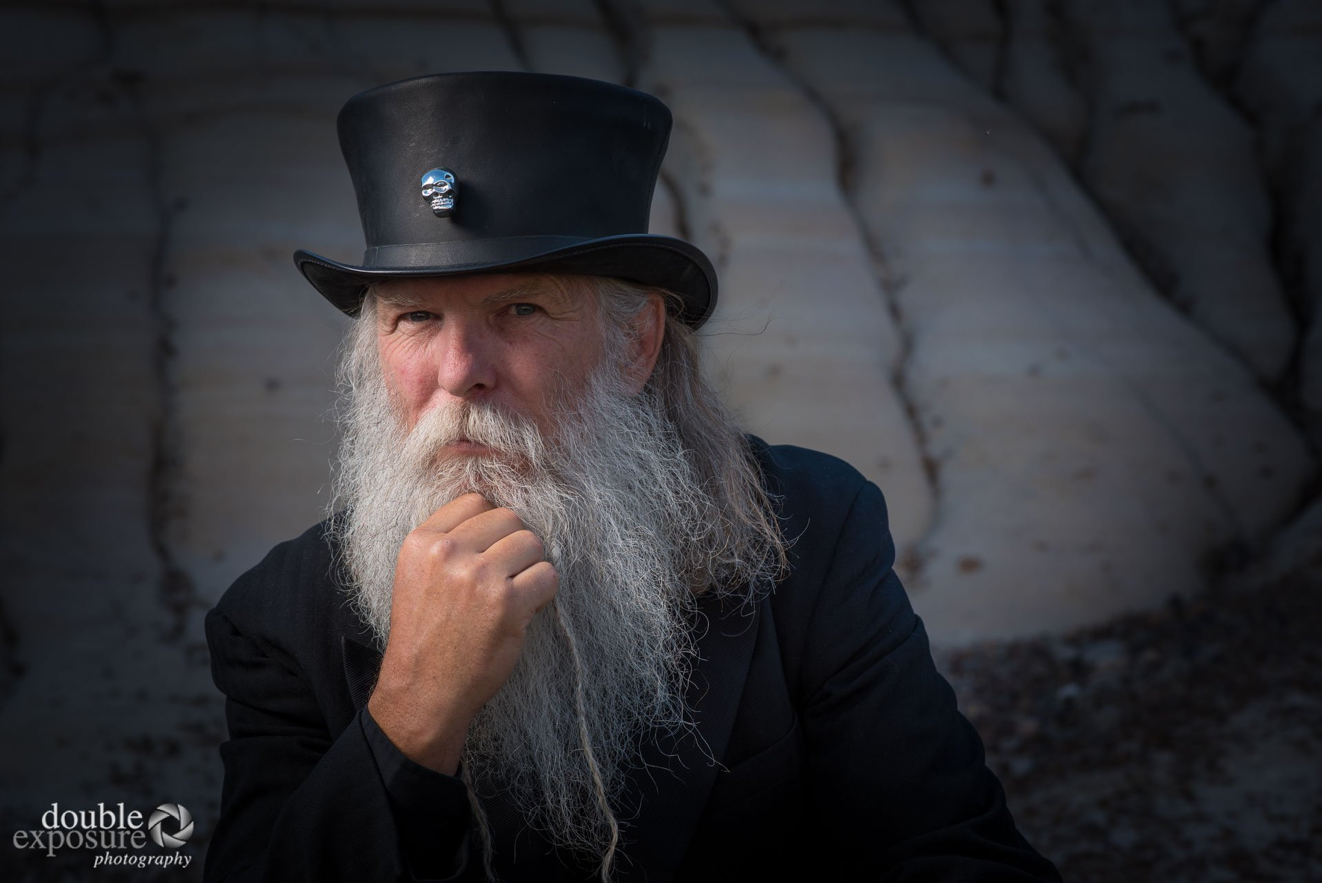 Old man with beard and tall hat.