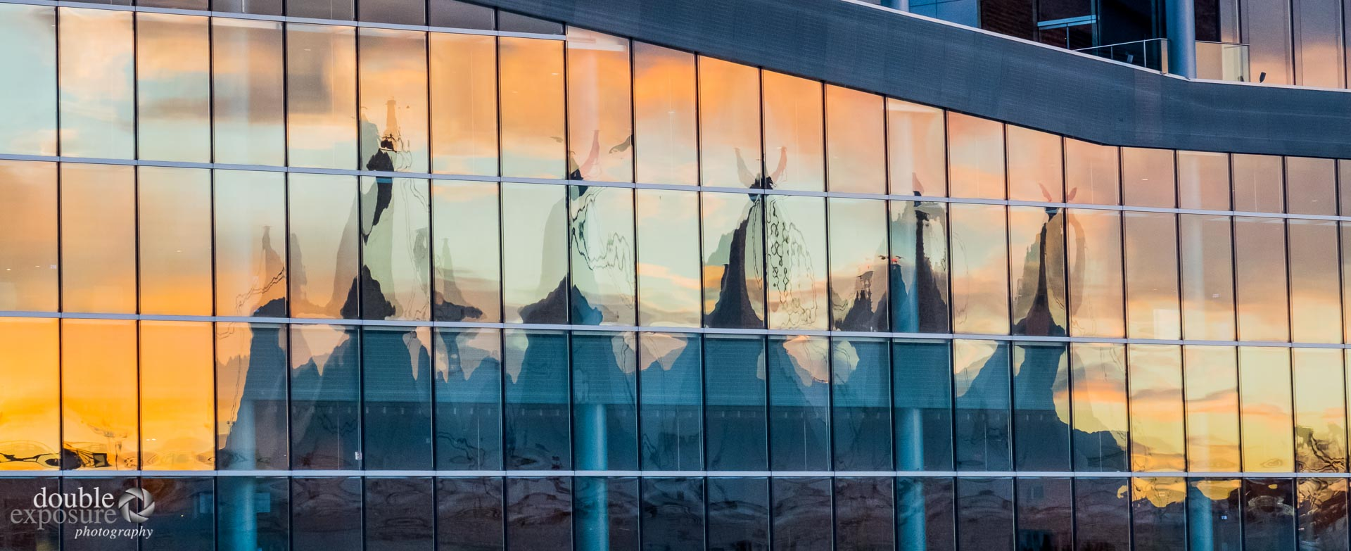 Vancouver Convention centre reflected at sunrise