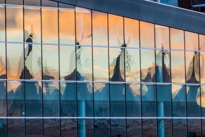 reflection of building in windows.