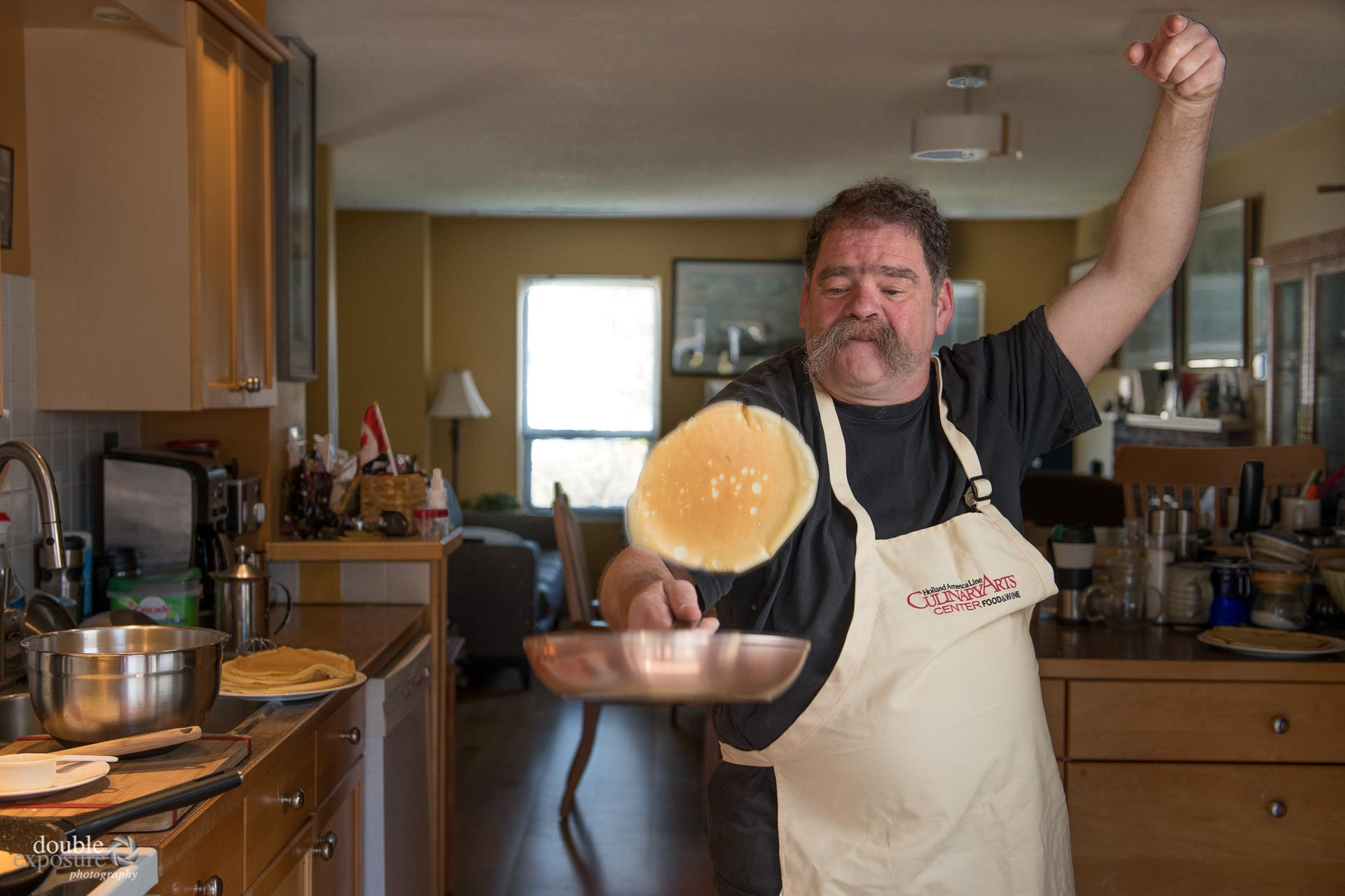 chef flips crepes