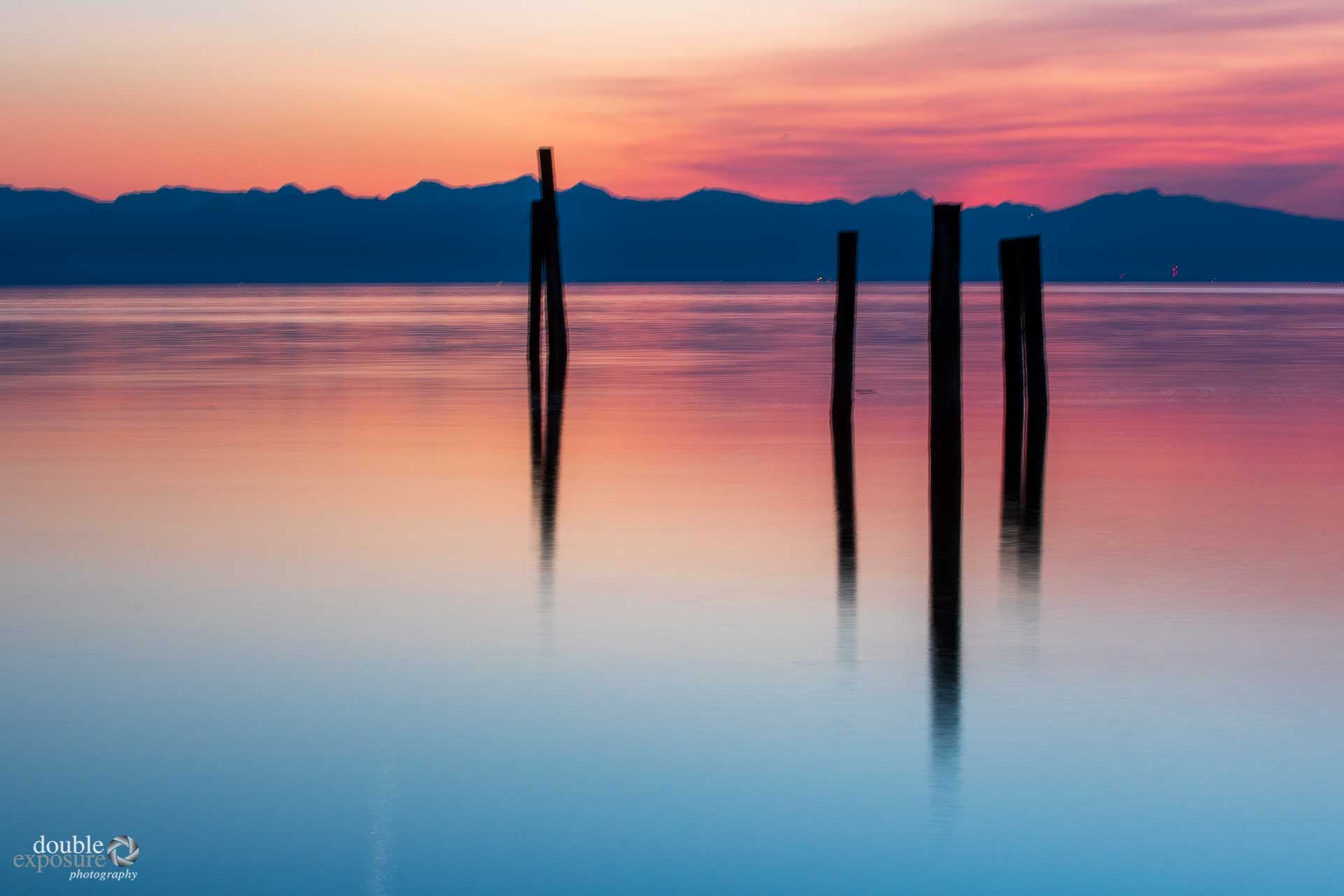 Old pilings in the ocean at sunset