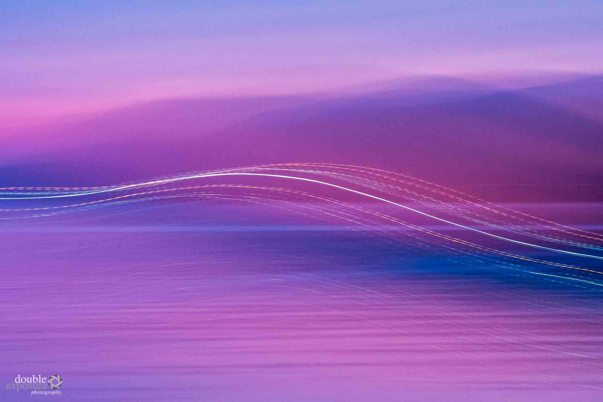 camera motion creates streaks of sunset light.