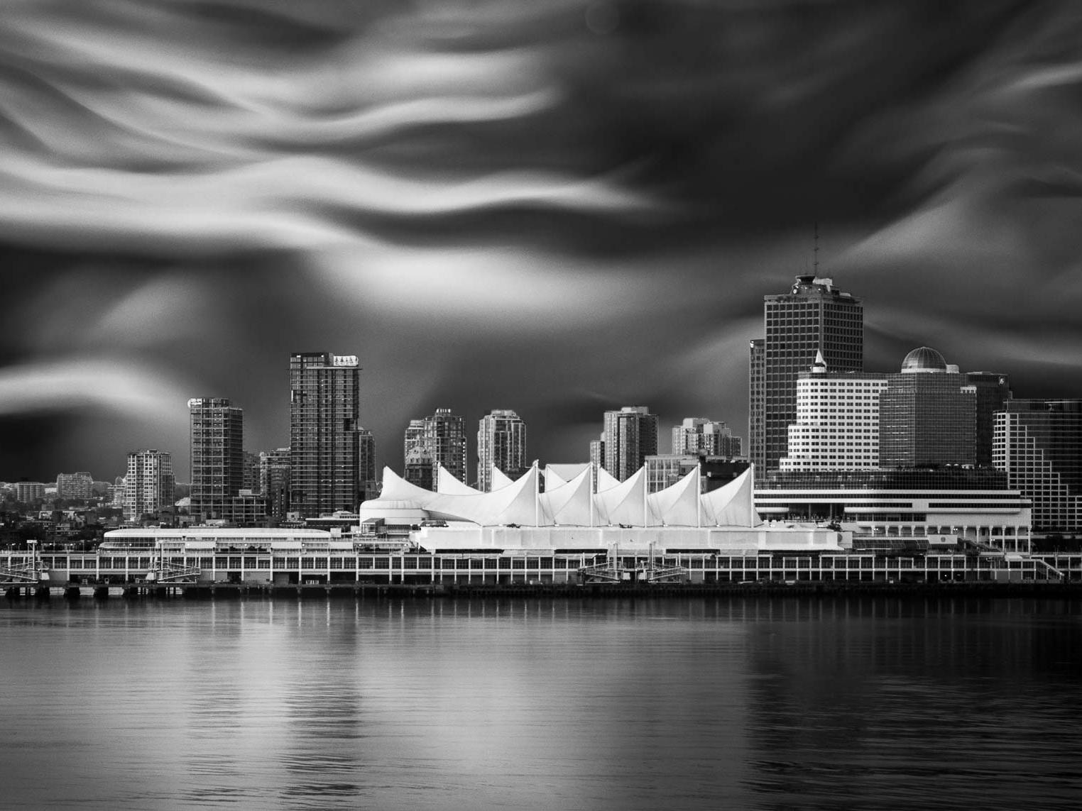 Vancouver's convention centre with a representation the flow of a Pacific weather system