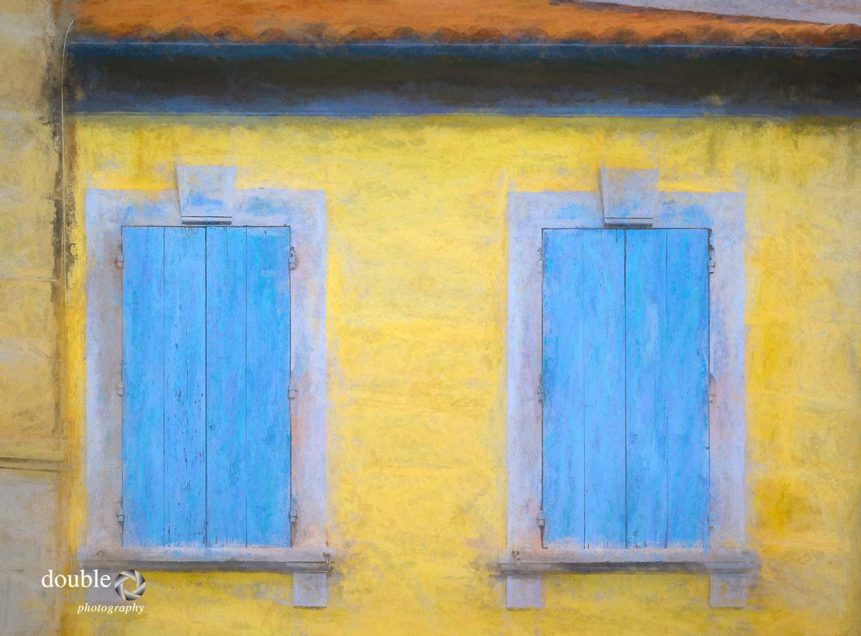 A pair of painted shutters in Arles