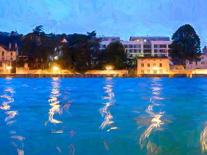Lights reflect on river in Arles France